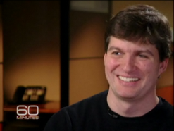 Picture of Michael Burry smiling in a 60 minutes interview